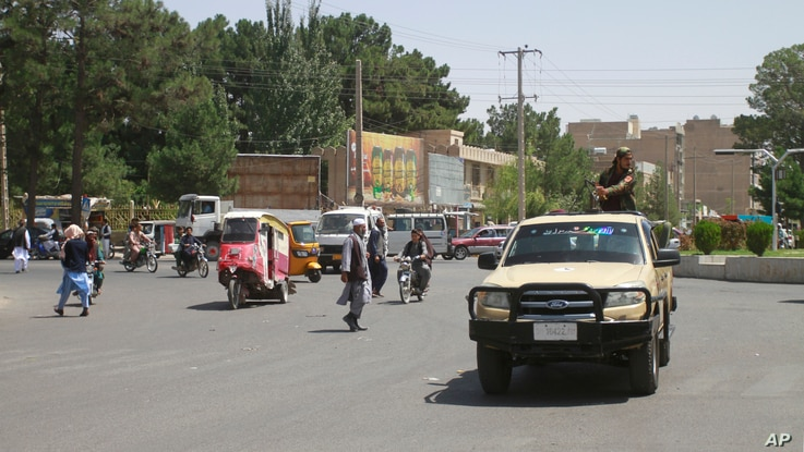 Members of the Taliban drive through the city of Herat, Afghanistan, west of Kabul, Aug. 14.2021, after taking the province from the Afghan government.