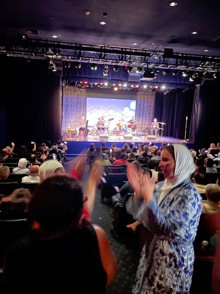 Attendees of the private concert are seen dancing to the music of Al-Madfai.