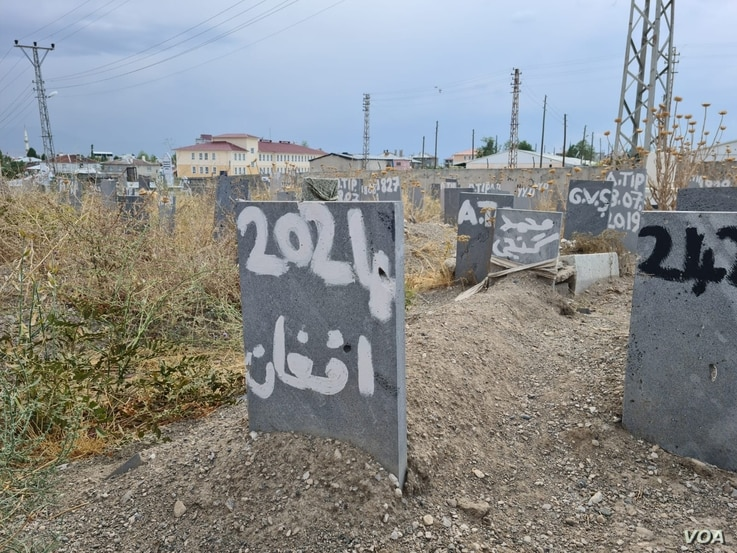 n a area of a graveyard set aside for the bodies of refugees found dead as they attempt to find safety, this grave says simply: