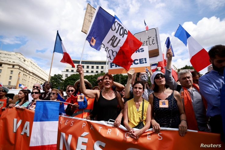 Protesters attend a demonstration called by the French nationalist party 'Les Patriotes' against restrictions, including a compulsory health pass, to fight COVID-19 outside the Ministry of Health in Paris, France, July 31, 2021.