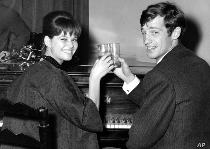 FILE - In this Nov. 3, 1960 file photo, French actor Jean-Paul Belmondo and Italian actress Claudia Cardinale attend a cocktail…