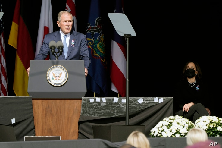 Former President George W. Bush speaks during a memorial for the passengers and crew of United Flight 93, Sept. 11, 2021, in Shanksville, Pennsylvania, on the 20th anniversary of the Sept. 11, 2001 attacks, as Vice President Kamala Harris looks on.