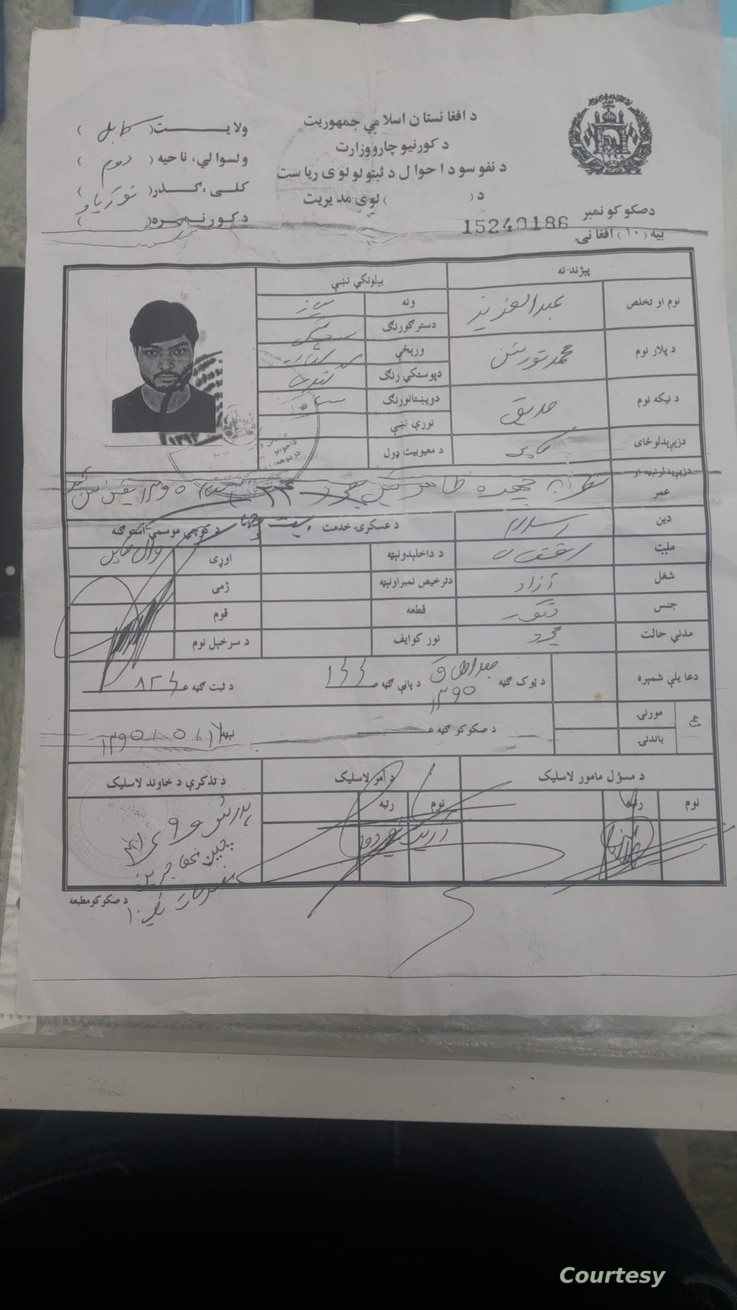 """This Afghan national ID card shows Uyghurs to be """"overseas Chinese."""" Abdulaziz Naseri is pictured on this card.(Abdulaziz Naseri)"""