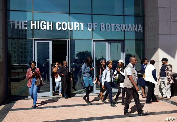 Activists leave Botswana High Court in Gaborone on June 11, 2019. Botswana's Court ruled on June 11 in favour of decriminalising homosexuality, handing down a landmark verdict greeted with joy by gay rights campaigners. / AFP / Tshekiso Tebalo