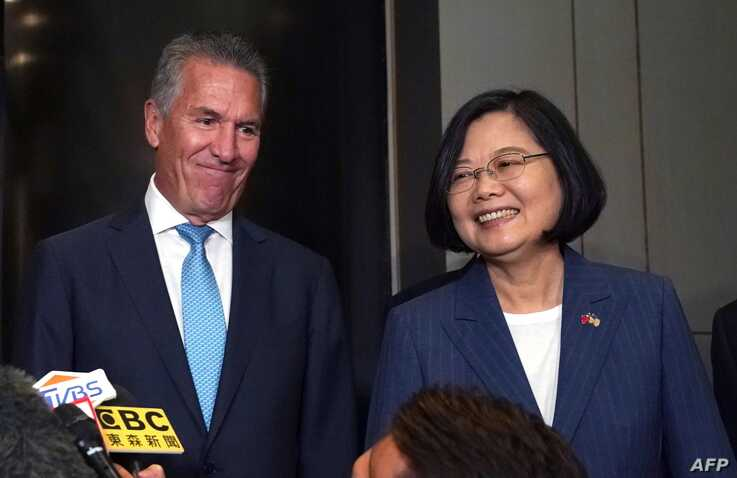 Taiwan's President Tsai Ing-wen talks to the press along with USTBC chairman/NASDAQ president Michael Splinter before they attend a Taiwan-US business summit organized by USTBC and Taiwan's trade organization TAITRA in New York July 12, 2019.