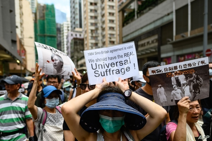 People take part in the 'Prayer walk for Sinners' rally in Hong Kong on August 31, 2019. Thousands of pro-democracy protesters defied a police ban on rallying in Hong Kong on August 31, a day after several leading activists and lawmakers were…