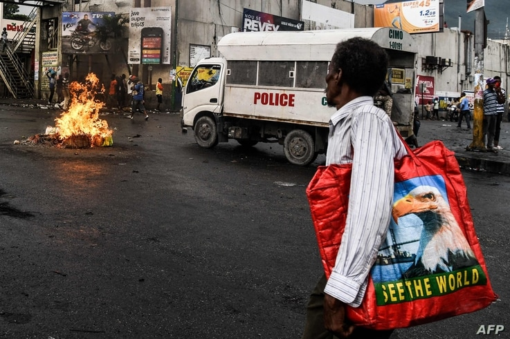 A man walks pass burning tires during a protest against fuel shortages and to demand the resignation of President Jovenel Moise, in Port-au-Prince, Haiti, on September 20, 2019.   Haiti's long-suffering population has faced an extra burden for more…