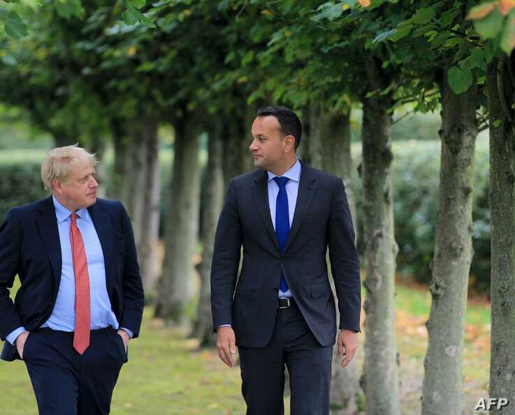 Ireland's Prime Minister, Leo Varadkar (L) and Britain's Prime Minister Boris Johnson (R) pose for a photograph at Thornton…
