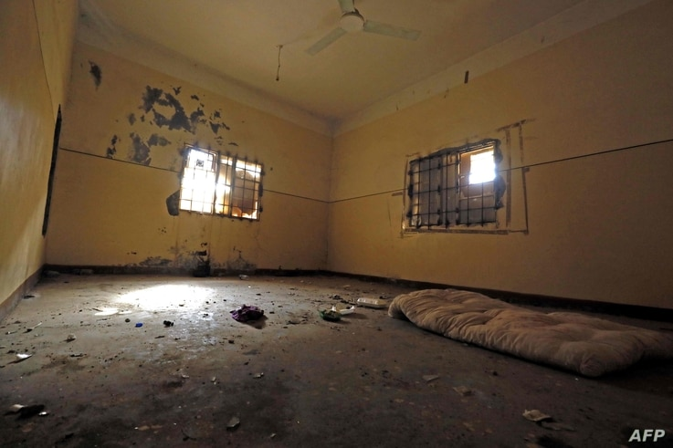 (FILES) This file picture taken on January 27, 2019 shows a view inside a former Islamic State (IS) group prison cell in the…