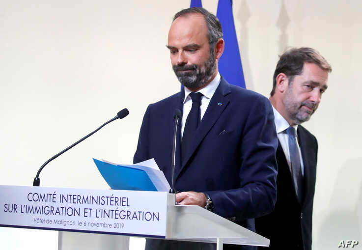 French Prime Minister Edouard Philippe (L) and French Minister of the Interior Christophe Castaner are about to leave after…