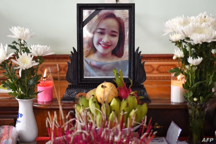 A portrait of Bui Thi Nhung, who is feared to be among the 39 people found dead in a truck in Britain, is kept on a prayer…