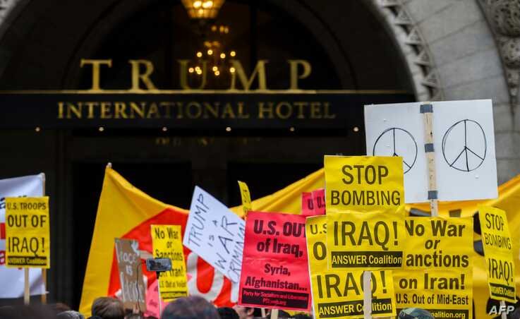 Anti-war activist demonstrate outside the Trump International Hotel in Washington, DC, on January 4, 2020. - Demonstrators are…