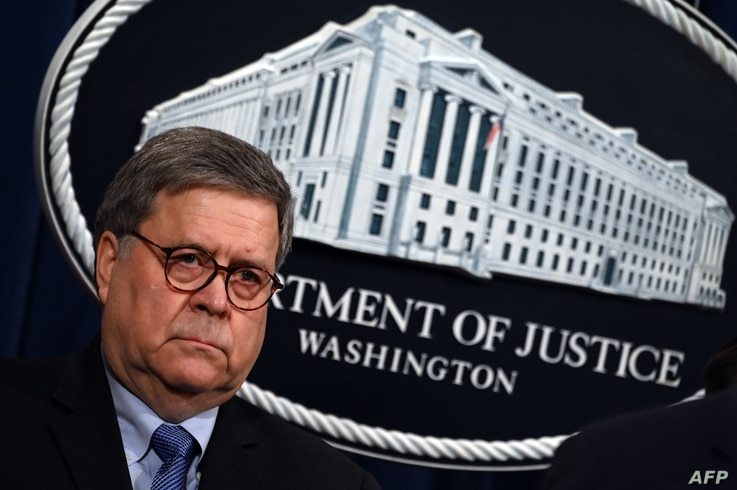 (FILES) In this file photo taken on January 13, 2020 US Attorney General William Barr holds a press conference regarding the…