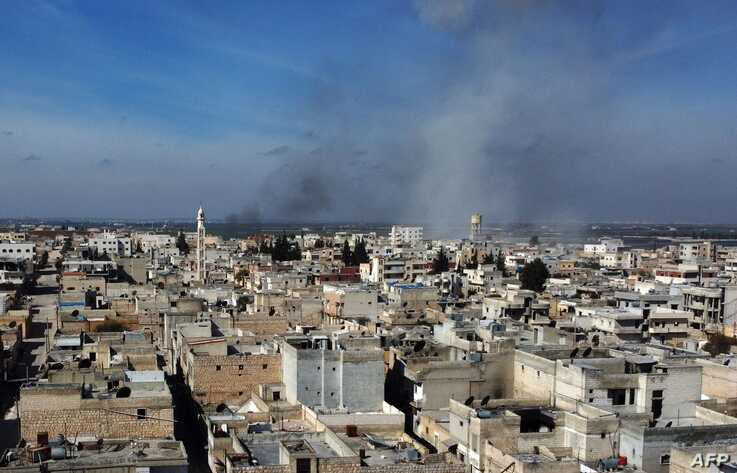 Smoke billows over the town of Saraqib in the eastern part of the Idlib province in northwestern Syria, following bombardment…
