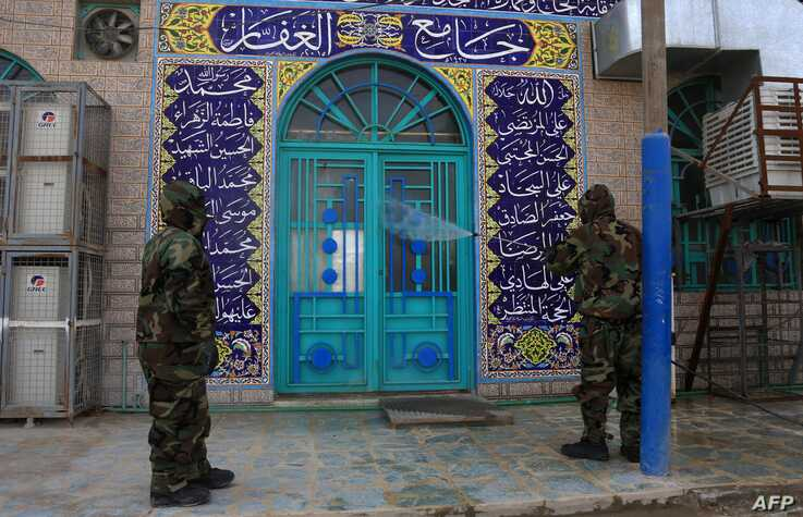 Soldiers disinfect the exterior of a mosque as a preventive measure against the spread of the coronavirus COVID-19, in the…