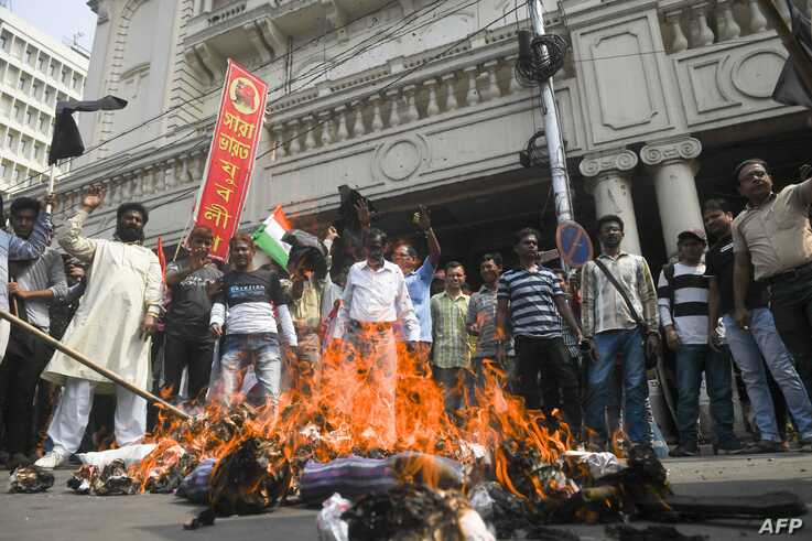 All India Youth League activists burn an effigy of Indian Minister of Home Affairs Amit Shah during a protest against India's…