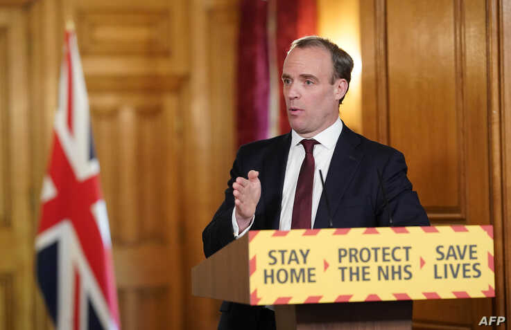 A handout image released by 10 Downing Street, shows Britain's Foreign Secretary Dominic Raab speaking during a remote press…