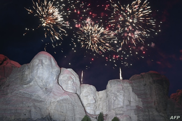 Fireworks explode above the Mount Rushmore National Monument during an Independence Day event attended by the US president in…