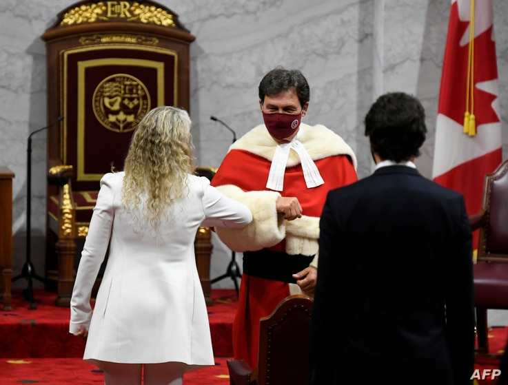 Canada's Governor General Julie Payette (L) greets Supreme Court of Canada Chief Justice Richard Wagner as she arrives with…