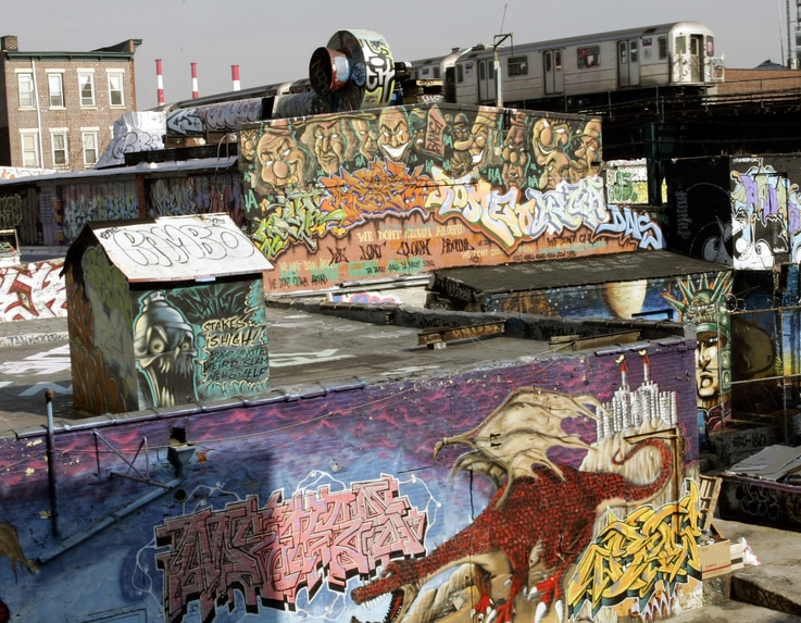 (FILES) In this file photo taken on February 22, 2006, the 7 Train passes by the 5 Pointz Building in Long Island City, Queens,…