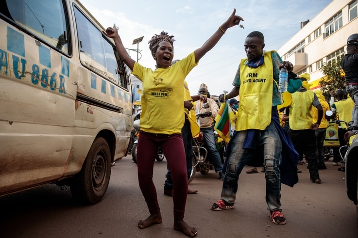 Supporters of the National Resistance Movement (NRM) celebrate the victory of President Yoweri Museveni after the results of...