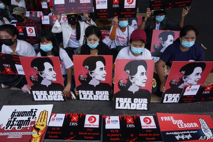Protesters hold signs of detained Myanmar civilian leader Aung San Suu Kyi during a demonstration against the military coup in…