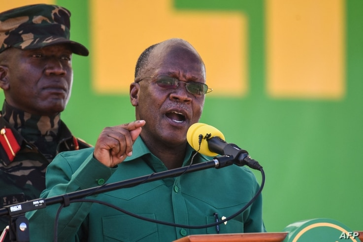 (FILES) In this file photo taken on August 29, 2020 Tanzania's incumbent President and presidential candidate of ruling party…