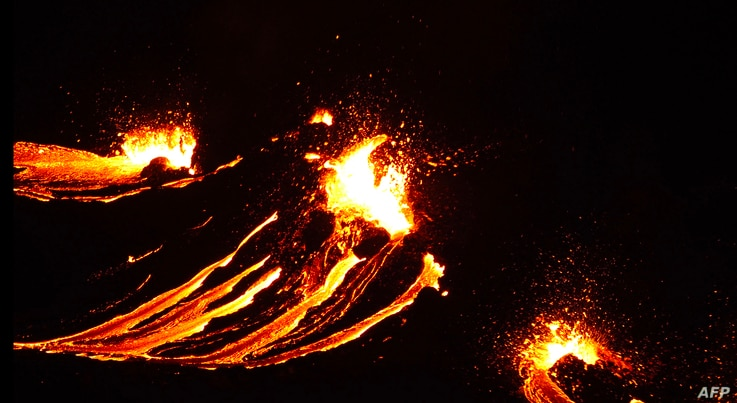 In this still image captured from a hand out video, filmed by the Icelandic Coast Guard, lava flows from the erupting…