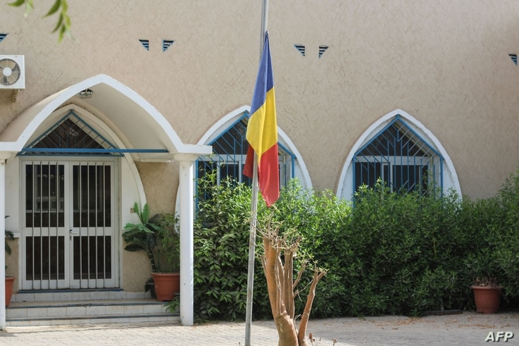 A Chad national flag flies at half mast outside a building on April 21, 2021, after Chad's President Idriss Deby Itno died on…