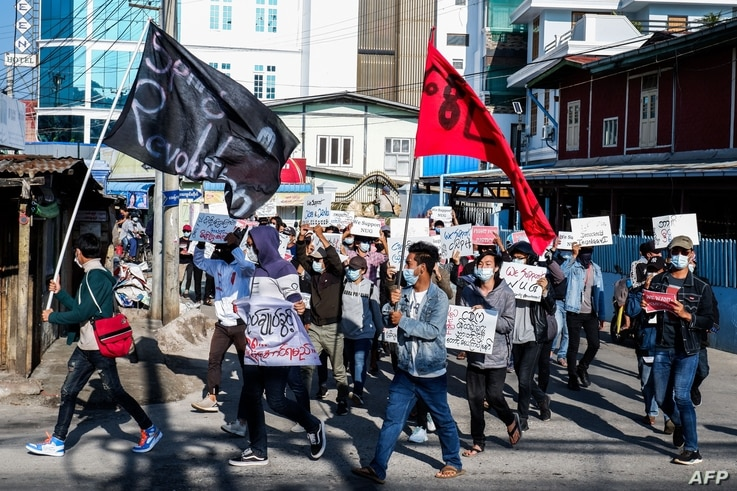 "Protesters take part in a demonstration against the military coup during ""Global Myanmar Spring Revolution Day"" in Taunggyi,…"