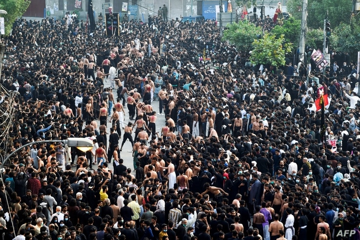 In this picture taken on May 4, 2021, Shiite Muslim devotees take part in a procession to commemorate the death anniversary of…