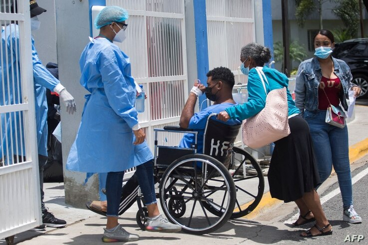 A man is admitted at the Covid unit of the Moscoso Puello hospital in Santo Domingo, on June 2, 2021 as the country suffers a…