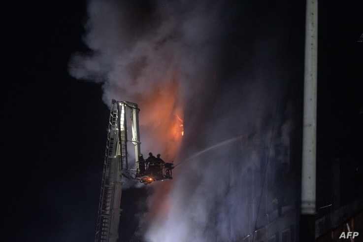 Firefighters try to extinguish a massive fire that broke out in a beverage and food factory in Narayanganj, central Bangladesh…