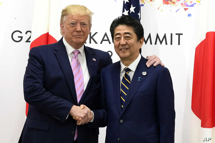 President Donald Trump meets with Japanese Prime Minister Shinzo Abe during a meeting on the sidelines of the G-20 summit in Osaka, Japan, Friday, June 28, 2019. (AP Photo/Susan Walsh)