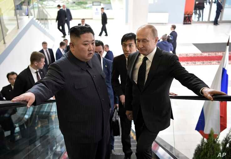Russian President Vladimir Putin, right, and North Korea's leader Kim Jong Un take an elevator heading to the talks in Vladivostok, Russia, Thursday, April 25, 2019. Putin and Kim are set to have one-on-one meeting at the Far Eastern State…