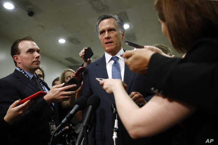 Sen. Mitt Romney, R-Utah, speaks to reporters after a classified members-only briefing on Iran, Tuesday, May 21, 2019, on Capitol Hill in Washington. (AP Photo/Patrick Semansky)
