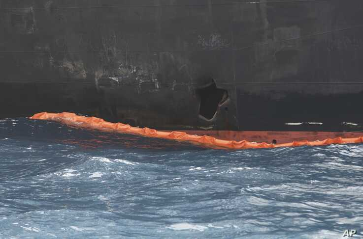 A hole the U.S. Navy says was made by a limpet mine is seen on the damaged Panama-flagged, Japanese owned oil tanker Kokuka Courageous, anchored off Fujairah, United Arab Emirates, during a trip organized by the Navy for journalists, on a Wednesday,…