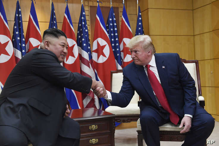 President Donald Trump meets with North Korean leader Kim Jong Un at the border village of Panmunjom in the Demilitarized Zone, South Korea, Sunday, June 30, 2019. (AP Photo/Susan Walsh)