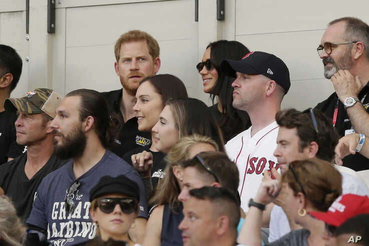 Britain's Prince Harry, top left, and Meghan, Duchess of Sussex, watch during the first inning of a baseball game between the Boston Red Sox and the New York Yankees, Saturday, June 29, 2019, in London. Major League Baseball made its European debut…