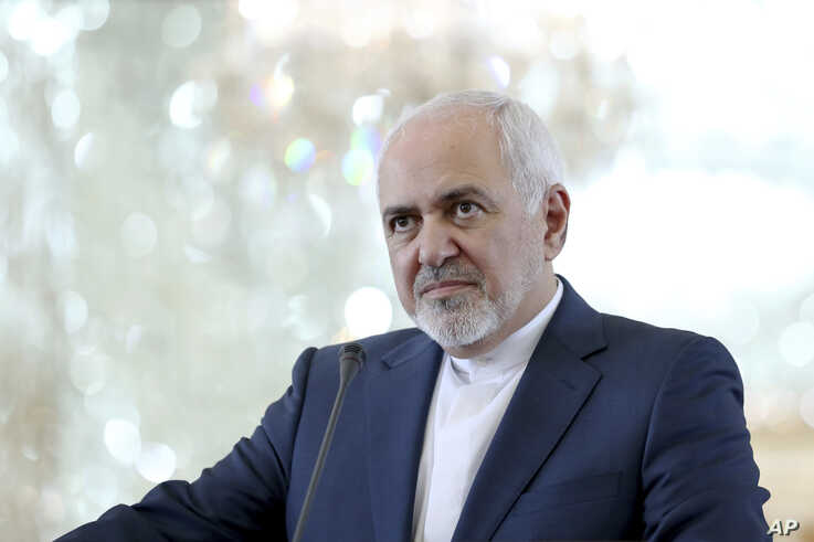"Iranian Foreign Minister Mohammad Javad Zarif speaks during a press conference with his German counterpart Heiko Maas after their talks in Tehran, Iran, Monday, June 10, 2019. Zarif warned the U.S. on Monday that it ""cannot expect to stay safe""…"