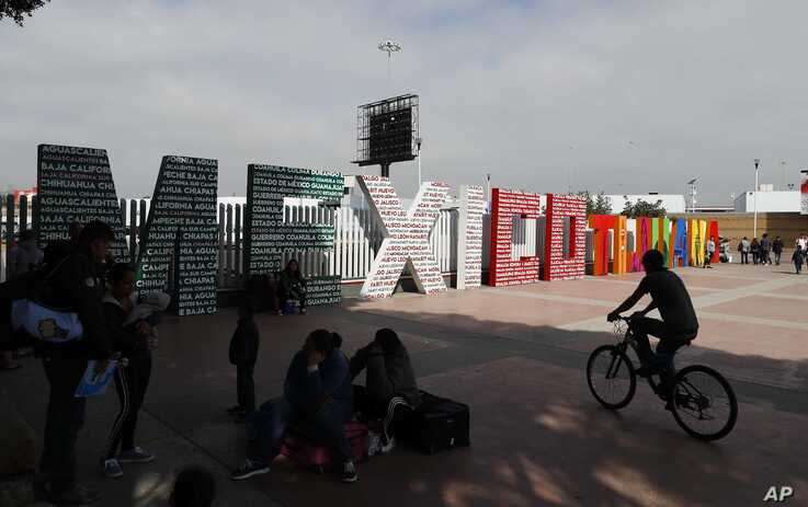 """The words """"Tijuana, Mexico"""" stand on the Mexican side of the border with the U.S. where migrants wait to be attended to apply for asylum in the U.S., in Tijuana, Mexico, Sunday, June 9, 2019. The mechanism that allows the U.S. to send migrants…"""