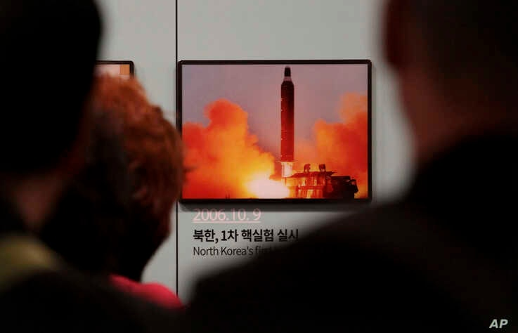 "Visitors watch a photo showing North Korea's missile launch at the Unification Observation Post in Paju, South Korea, near the border with North Korea, Friday, April 19, 2019. North Korea said Thursday that it had test-fired a new type of ""tactical…"