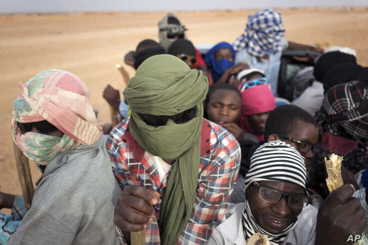FILE - In this Monday, June 4, 2018 file photo, Nigeriens and third-country migrants head towards Libya from Agadez, Niger. Algeria's deadly expulsions of migrants into the Sahara Desert have nearly ground to a halt after widespread condemnation and…