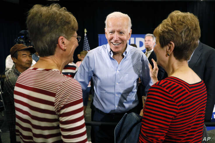 Democratic presidential candidate former Vice President Joe Biden greets audience members after speaking at Clinton Community College, June 12, 2019, in Clinton, Iowa.