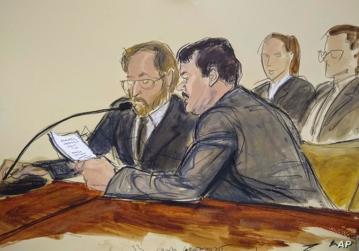 In this courtroom sketch, Joaquin 'El Chapo' Guzman, foreground right, reads a statement through an interpreter during his sentencing in federal court, July 17, 2019, in New York.
