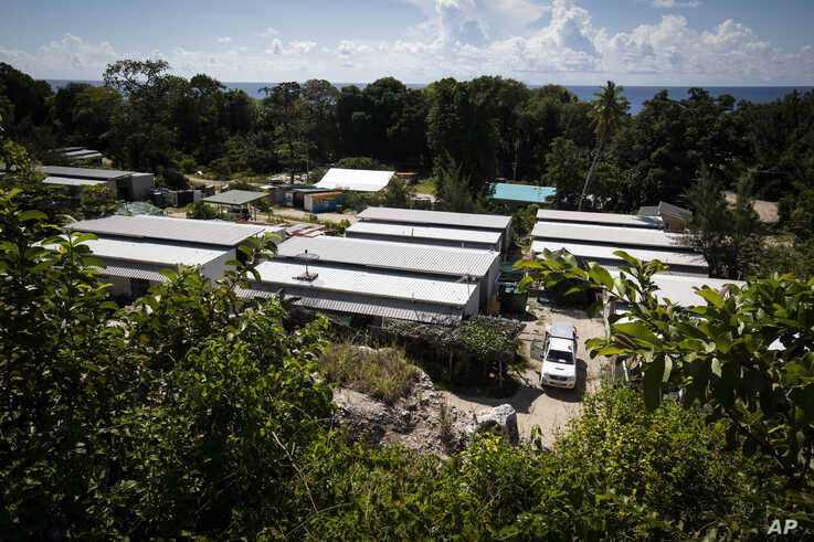 FILE - This Sept. 4, 2018, file photo shows Nibok refugee settlement on Nauru. Australia announced on Sunday, Feb. 3, 2019 that the last child refugees held on the Pacific atoll of Nauru will soon the sent to the United States, ending the banishment…