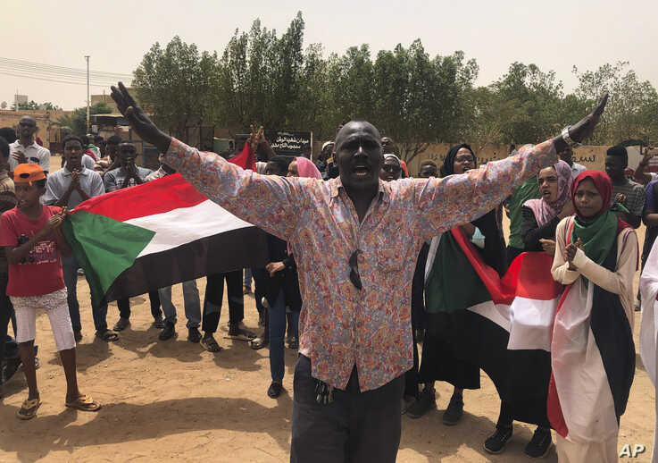 A Sudanese protester shouts slogans during a demonstration against the military council, in Khartoum, Sudan, June 30, 2019.