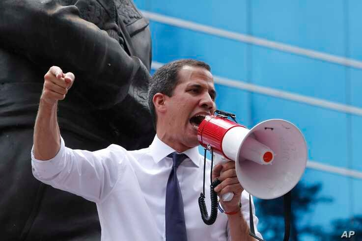 Venezuela's self proclaimed interim President Juan Guaido speaks during a protest in Caracas, Venezuela, Friday, July 5, 2019. Guaidó called on Venezuelans to take to the streets with him Friday for demonstrations marking 208 years since Venezuela…
