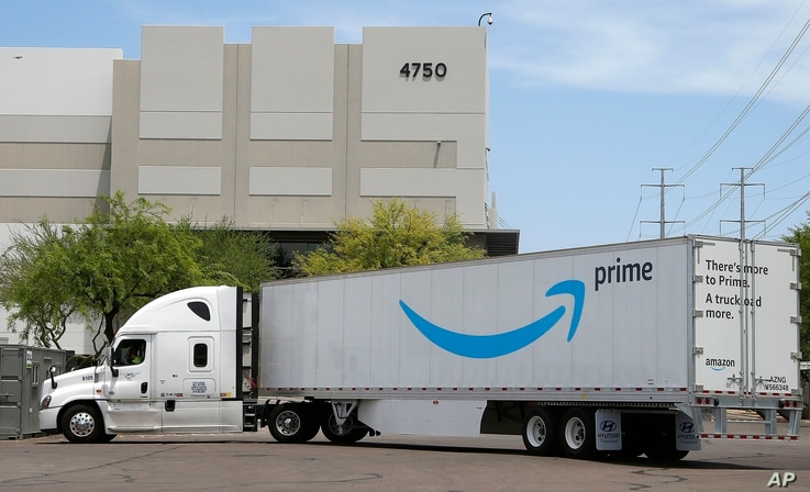 ThAn Amazon shipping truck at a fulfillment center in Phoenix, July 17, 2019. Amazon.com Inc. reported financial information Thursday.s Wednesday, July 17, 2019 photo shows an Amazon shipping truck at a fulfillment center in Phoenix. Amazon.com Inc. reports financial earnings on Thursday, July 25. (AP Photo/Ross D. Franklin)