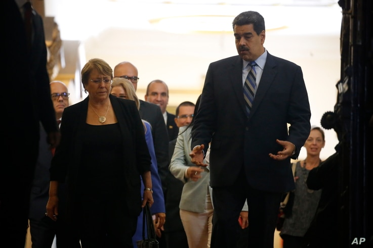 U.N. High Commissioner for Human Rights Michelle Bachelet, left, chats with Venezuela's President Nicolas Maduro, as they walk out of a meeting at Miraflores Presidential Palace, in Caracas, Venezuela, Friday, June 21, 2019. The United Nations' top…